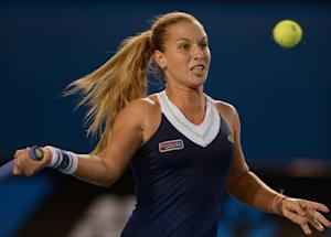Dominika Cibulkova plays a shot during her match against …