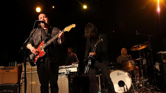 Alain Johannes, left, and Dave Grohl and Taylor Hawkins, of the Foo Fighters perform with the Sound City Players at Park City Live Day 2 on Friday, January 18, 2013, in Park City, Utah. (Photo by Barry Brecheisen/Invision for Park City Live/AP Images)
