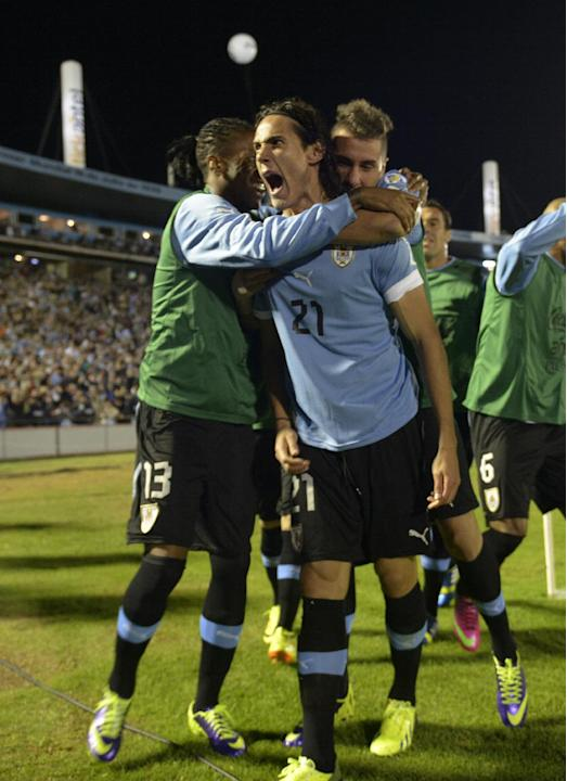 Uruguay's Edinson Cavani, center, celebrates with teammates after scoring against Argentina during a 2014 World Cup qualifying soccer game in Montevideo, Uruguay, Tuesday, Oct. 15, 2013