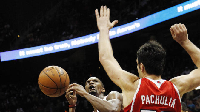 Miami Heat center Chris Bosh (1) is fouled as he is defended by Atlanta Hawks power forward Zaza Pachulia (27) in the second half of an NBA basketball game in Atlanta, Friday, Nov. 9, 2012. Miami won 95-89. (AP Photo/John Bazemore)