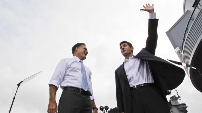 Republican presidential candidate, former Massachusetts Gov. Mitt Romney, left, introduces his vice presidential running mate, Wisconsin Rep. Paul Ryan, Saturday, Aug. 11, 2012 in Norfolk, Va.  (AP Photo/Mary Altaffer)