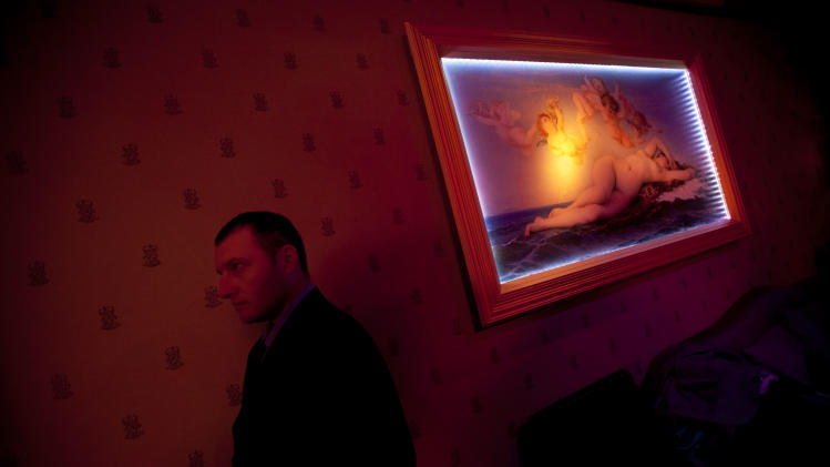 In this March. 9, 2012 photo, a Russian-speaking Israeli security guard works the VIP room of the Russian Soho nightclub in Tel Aviv, Israel. The club caters to the Russian-speaking immigrant community, featuring hired dancers and extravagant decorations rarely seen in informal Israel.  (AP Photo/Oded Balilty)