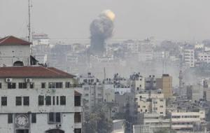 Flames and smoke are seen following what witnesses said was an Israeli air strike, in Gaza City