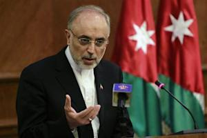 Iran's Foreign Minister Ali Akbar Salehi speaks during his joint news conference with his Jordanian counterpart Nasser Judeh in Amman