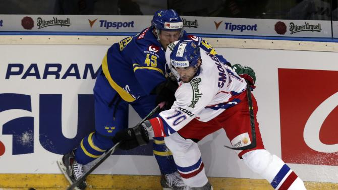 Czech Republic's Smolenak fights for the puck with Sweden's Moller during their Euro Hockey Tour ice hockey match in Prague
