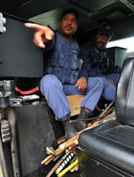 &lt;p&gt;Police carry arms confiscated from miners in Marikana. Striking South African miners have called for a &quot;peaceful march&quot; on a police station Sunday after authorities launched a major crackdown in the country&#39;s restive platinum belt.&lt;/p&gt;