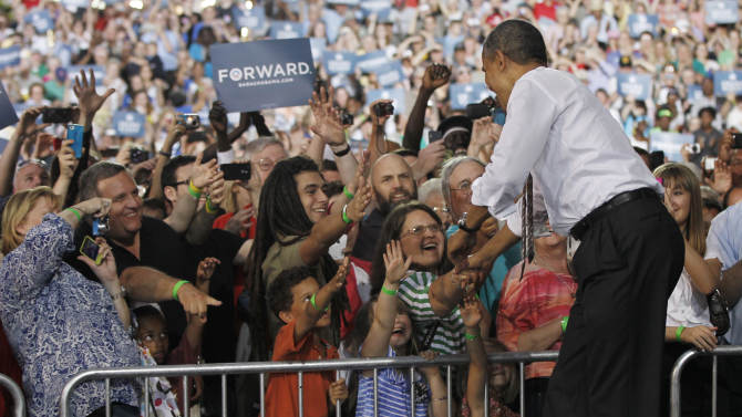 President Barack Obama greets supporter at a campaign rally at the Paul R. Knapp Animal learning center, Thursday, May 24, 2012 in Des Moines, Iowa. (AP Photo/Pablo Martinez Monsivais)