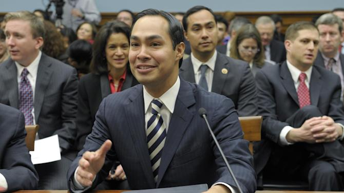 San Antonio, Texas Mayor Julian Castro, center, accompanied by his brother Rep. Joaquin Castro, D-Texas, second from right, gestures on Capitol Hill in Washington, Tuesday, Feb. 5, 2013, prior to testifying before the House Judiciary Committee hearing on America's Immigration System: Opportunities for Legal Immigration and Enforcement of Laws against Illegal Immigration.  (AP Photo/Susan Walsh)
