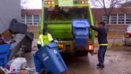 An Emterra crew picks up recycling from a back lane in Winnipeg's Weston neighbourhood on Tuesday afternoon.