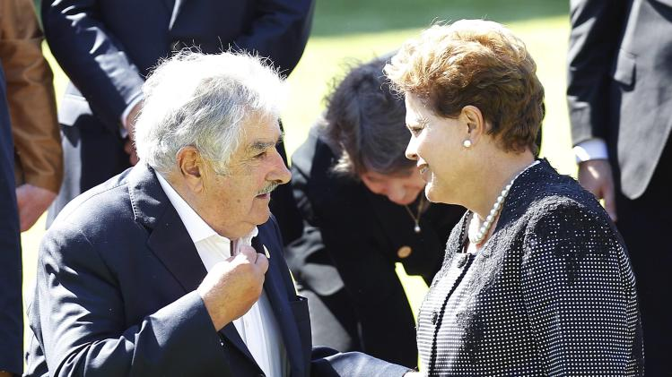 Brazil's president Rousseff speaks with Uruguay's president Mujica after a meeting at Cerro Castillo Presidential Palace with Chilean president Michelle Bachelet in Vina del Mar city.