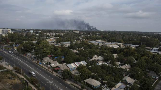 Smoke rises near the Donetsk Sergey Prokofiev International Airport after recent shelling in Donetsk, eastern Ukraine