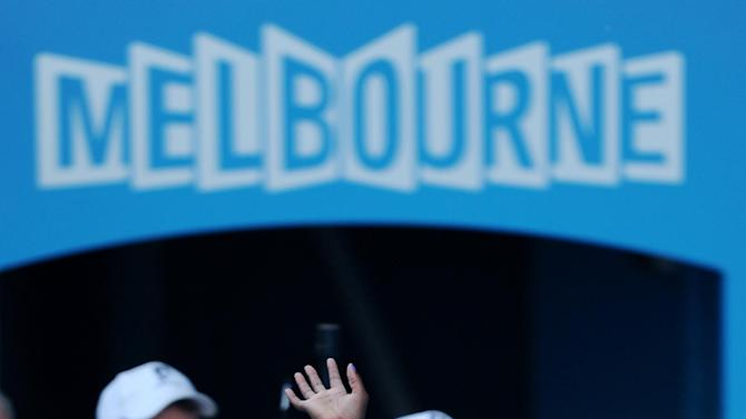 Sloane Stephens of the US waves as she leaves Rod Laver Arena after losing her semifinal match against Victoria Azarenka of Belarus at the Australian Open tennis championship in Melbourne, Australia, Thursday, Jan. 24, 2013. (AP Photo/Andrew Brownbill)