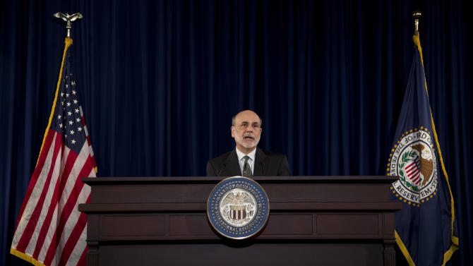 Fed open to linking rate hike to economic gauge