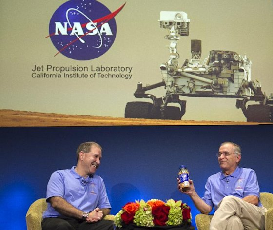 John Grunsfeld, NASA Associate Administrator, NASA Headquarters, left, and Charles Elachi, JPL Director, NASA Jet Propulsion Laboratory, present a can of &quot;good luck&quot; peanuts during an overview of the status and plans for NASA&#39;s Science Mission Directorate at NASA&#39;s JPL in Pasadena, Calif., Sunday, August 5, 2012. After traveling 8 1/2 months and 352 million miles, Curiosity will attempt a landing on Mars Sunday night. (AP Photo/Damian Dovarganes)