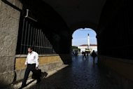 &lt;p&gt;A man passes through a tunnel near Rossio Square in downtown Lisbon in 2011. Portugal can still reach its 2012 budget targets but the risk of failure has grown significantly, officials from the European Commission and International Monetary Fund said on Tuesday.&lt;/p&gt;