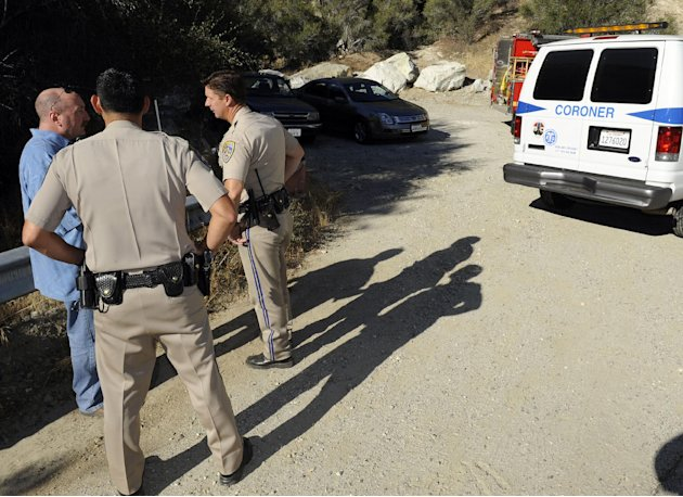 California Highway patrol officers investigate the scene of two cars that were recovered at the bottom of a remote mountain  in Castaic, Calif., Friday, Sept. 30, 2011 .    David Lavau, whose car had