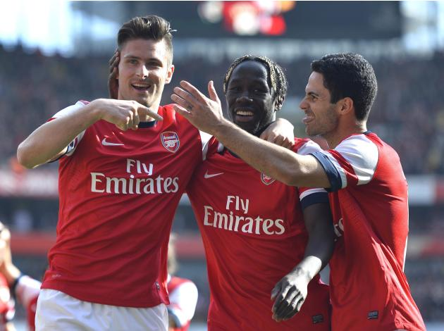 Arsenal's Giroud, Sagna and Arteta celebrate Giroud's goal against Everton during their English FA Cup quarter final soccer match at the Emirates stadium in London