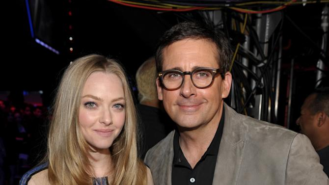 IMAGE DISTRIBUTED FOR MTV - Actors Amanda Seyfried, left, and Steve Carell pose backstage at the MTV Movie Awards in Sony Pictures Studio Lot in Culver City, Calif., on Sunday April 14, 2013. (Photo by John Shearer/Invision for MTV/AP Images)
