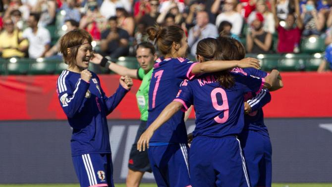 Japan players celebrate a goal on a penalty kick by Aya Miyama against England during the first half of a semifinal in the FIFA Women's World Cup soccer tournament, Wednesday, July 1, 2015, in Edmonton, Alberta, Canada. (Jason Franson/The Canadian Press via AP)