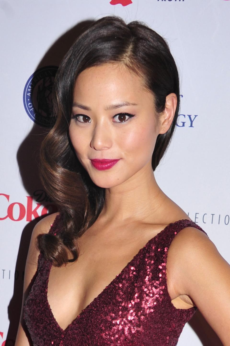 Jamie Chung attends the Red Dress Collection 2013 Fashion Show, on Wednesday, Feb. 6, 2013 in New York. (Photo by Charles Sykes/Invision/AP)