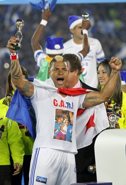 Millonarios player Torres celebrates after his team defeated Independiente Medellin during the Colombian First Division soccer in Bogota