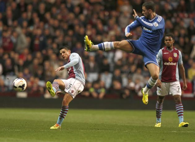 Chelsea's Hazard challenges Aston Villa's Westwood during their English Premier League soccer match at Villa Park in Birmingham