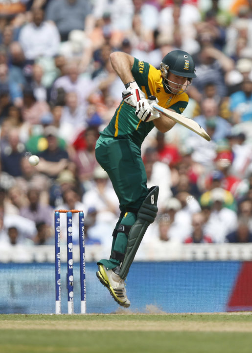 South Africa's David Miller plays a shot off the bowling of England's Steven Finn during their ICC Champions Trophy semifinal cricket match at the Oval cricket ground in London, Wednesday, June 19, 20