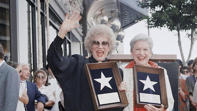 FILE - In this Oct. 1, 1987 file photo, Patty, left, and Maxine Andrews, of the famed Andrews Sisters, smile as they hold their star plaques which they received as they accepted a star in the Hollywood Walk of Fame. Patty Andrews, the last survivor of the three singing Andrews sisters, has died in Los Angeles at age 94. Andrews died Wednesday, Jan. 30, 2013, at her home in suburban Northridge of natural causes, said family spokesman Alan Eichler. (AP Photo/Reed Saxon, File)