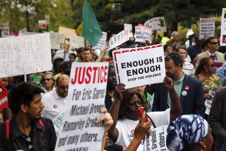 """People take part in the """"We Will Not Go Back"""" march and rally for Eric Garner in the Staten Island borough of New York"""