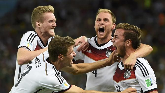 Germany's Goetze celebrates his goal against Argentina with teammates during extra time in their 2014 World Cup final at the Maracana stadium in Rio de Janeiro