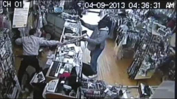 Chicago store owner fights off robber with baseball bat