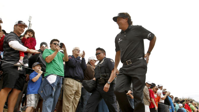 Phil Mickelson walks past the gallery on his way to the third hole during the final round of the Waste Management Phoenix Open golf tournament on Sunday, Feb. 3, 2013, in Scottsdale, Ariz. (AP Photo/Ross D. Franklin)