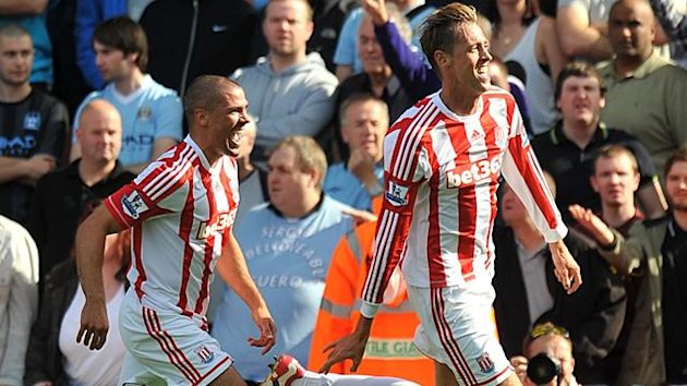 Stoke City's Peter Crouch celebrates scoring the opening goal of the game (PA Photos)