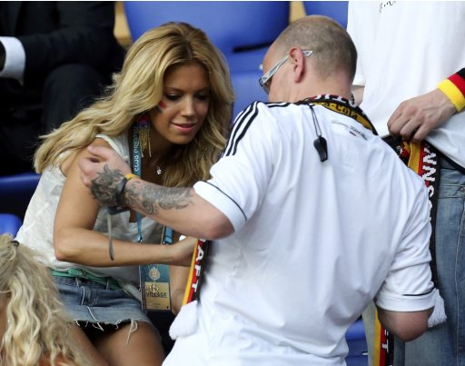 Netherlands' van der Vaart's wife Sylvie signs autographs to German fans before the Euro 2012 soccer match between Netherland and Germany in Kharkiv