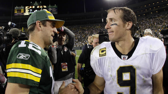 Green Bay Packers quarterback Aaron Rodgers (12) talks to New Orleans Saints quarterback Drew Brees after an NFL football game Thursday, Sept. 8, 2011, in Green Bay, Wis. The Packers won 42-34. (AP Photo/Morry Gash)