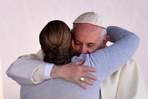 Pope Francis is greeted by a female inmate during his…