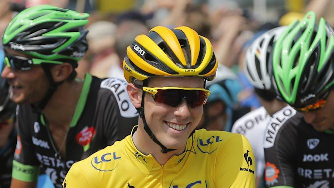 Australia's Rohan Dennis, wearing the overall leader's yellow jersey, waits for the start of the second stage of the Tour de France cycling race over 166 kilometers (103 miles) with start in Utrecht and finish in Neeltje Jans, Netherlands, Sunday, July 5, 2015. (AP Photo/Christophe Ena)