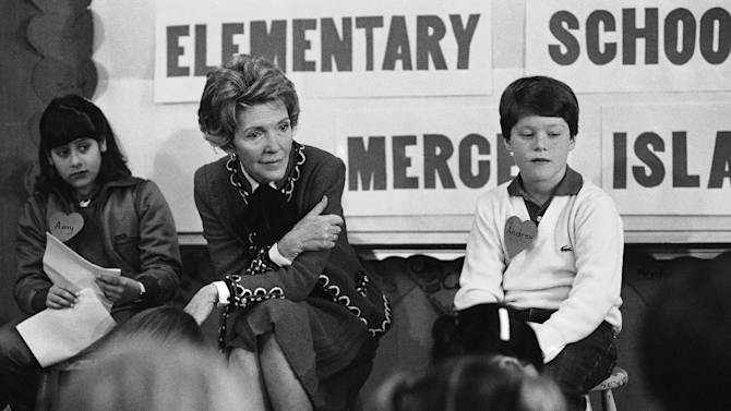 """FILE - In this Feb. 14, 1984 file photo, first lady Nancy Reagan sits with a fourth and fifth grade class at Island Park Elementary School on Mercer Island, Wash. where she participated in a drug education class. At left is Amy Clarfeld, 10, and Andrew Cary, 10, is at right. During a visit with schoolchildren in Oakland, Calif., Reagan later recalled, """"A little girl raised her hand and said, 'Mrs. Reagan, what do you do if somebody offers you drugs?' And I said, 'Well, you just say no.' And there it was born."""" On the occasion of  """"Legalization Day,"""" Thursday, Dec. 6, 2012, when Washington's new law takes effect, AP takes a look back at the cultural and legal status of the """"evil weed"""" in American history. (AP Photo/Barry Sweet, File)"""