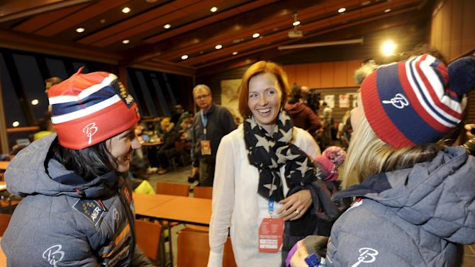 Norwegian skiers Bjorgen and Johaug speak with former Finnish World Champion skier Sarasvuo during a news conference at the FIS World Cup Ruka Nordic Opening in Kuusamo