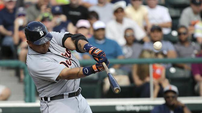 Detroit Tigers third baseman Miguel Cabrera hits a fly ball during an exhibition baseball game against the Atlanta Braves, Friday, Feb. 22, 2013, in Kissimmee, Fla. Cabrera was out on the play. (AP Photo/David J. Phillip)