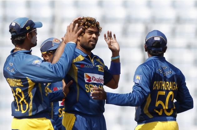 Sri Lanka's fielders congratulate Malinga as he dismissed Pakistan's Khan successfully during their 2014 Asia Cup final match in Dhaka