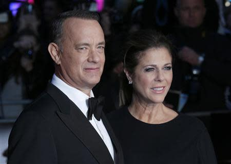 "Actor Tom Hanks and his wife Rita Wilson arrive for the European premiere of ""Captain Phillips"", on the opening night of the London Film Festival, at the Odeon Leicester Square, in central London"
