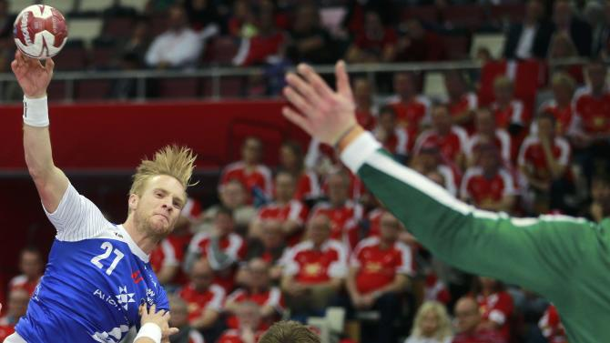 Jonsson of Iceland attempts to scores past Landin of Denmark during their round of 16 match of the 24th men's handball World Championship in Doha