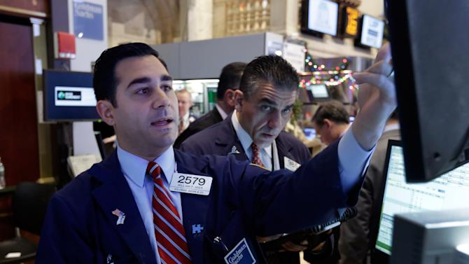 Stocks slip as Fed starts stimulus discussion