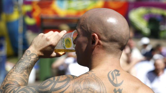 An England fan takes a drink in the fan zone in Kiev, Ukraine, Sunday, June 24, 2012. England will play Italy in a Euro 2012 quarterfinal soccer match later Sunday. (AP Photo/Kirsty Wigglesworth)