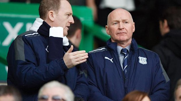 John Brown, right, watched from the stands as Dundee were comprehensively beaten
