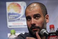 FC Barcelona's coach Pep Guardiola attends a a press conference in Yokohama, near Tokyo, Monday, Dec. 12, 2011. Barcelona will play a semi-final match in FIFA Club World Cup Thursday. (AP Photo/Junji Kurokawa)