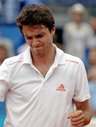 France's Gilles Simon reacts during his semi-final match against Spain's Nicolas Almagro at the Nice ATP tennis tournament, Friday May 25, 2012, southern France.(AP Photo/CHrsitian Alminana)