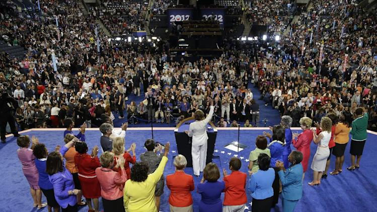 House Minority Leader Nancy Pelosi waves to delegates with women from the House of Representatives at the Democratic National Convention in Charlotte, N.C., on Tuesday, Sept. 4, 2012. (AP Photo/Charlie Neibergall)
