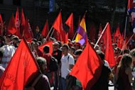 People take part in a demonstration in Madrid. Tens of thousands of chanting protesters from across Spain packed the centre of Madrid on Saturday for a rally against government austerity measures aimed at avoiding the need for a bailout